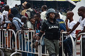 Nigeria Police Force - Female police officer during Eyo festival