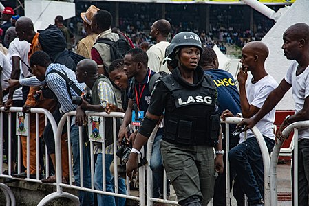 A Nigerian police officer at the Eyo festival in Lagos Nigerian female police.jpg