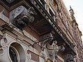 Old facade with ornaments and decorations in Amsterdam city - free photo, Fons Heijnsbroek.jpg