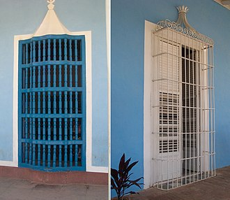 Plaza Mayor, Trinidad, Cuba - The barrotes of the 18th century (left), were replaced in the 19th century by grilles decorated with ornamental motifs (right)