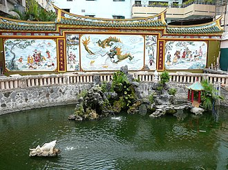 Quan Âm Pagoda (Ho Chi Minh City) - The relief panels surrounding the artificial pond have Taoist motifs.