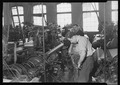 Paterson, New Jersey - Textiles. Madison Silk Co. Setting new warp onto loom. - NARA - 518611.tif