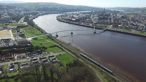 Peace Bridge (Foyle) - A view of the Peace Bridge showing both sides of the river and a passing train