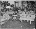 "Photograph of President Truman and First Lady Bess Truman enjoying a Sunday luncheon on the lawn of the ""Little White... - NARA - 199049.tif"