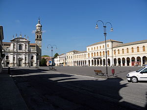 Crespino - Fetonte Square, at left the baroque facade of Santi Martino and Severo Church and at right the Town Hall