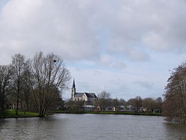 The church of Saint-Nicolas, seen beyond the water from Mûrier