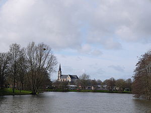 Craon, Mayenne - The church of Saint-Nicolas, seen beyond the water from Mûrier