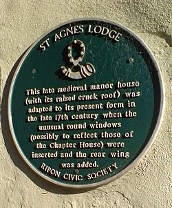 Photo of St Agnes Lodge green plaque