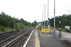 Platform starter signals at Hooton station looking south (28034930204).jpg