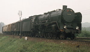 DRG Class 03 - An 03 running in Poland as PKP No. Pm2-34, today preserved at Warsaw, near Toruń with a northbound freight; 1976