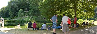 """Pokémon Go - Players gathering around a """"gym"""" in a park in Brest, France"""