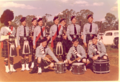 Police Pipe Band at Wooroolin (probably attending the Wooroolin – Tingoora R.S.L. Highland Gathering and Sports Day), 1961.webp