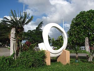 Culture of Vanuatu - A memorial in Port Vila representing totem poles and a rounded tusk