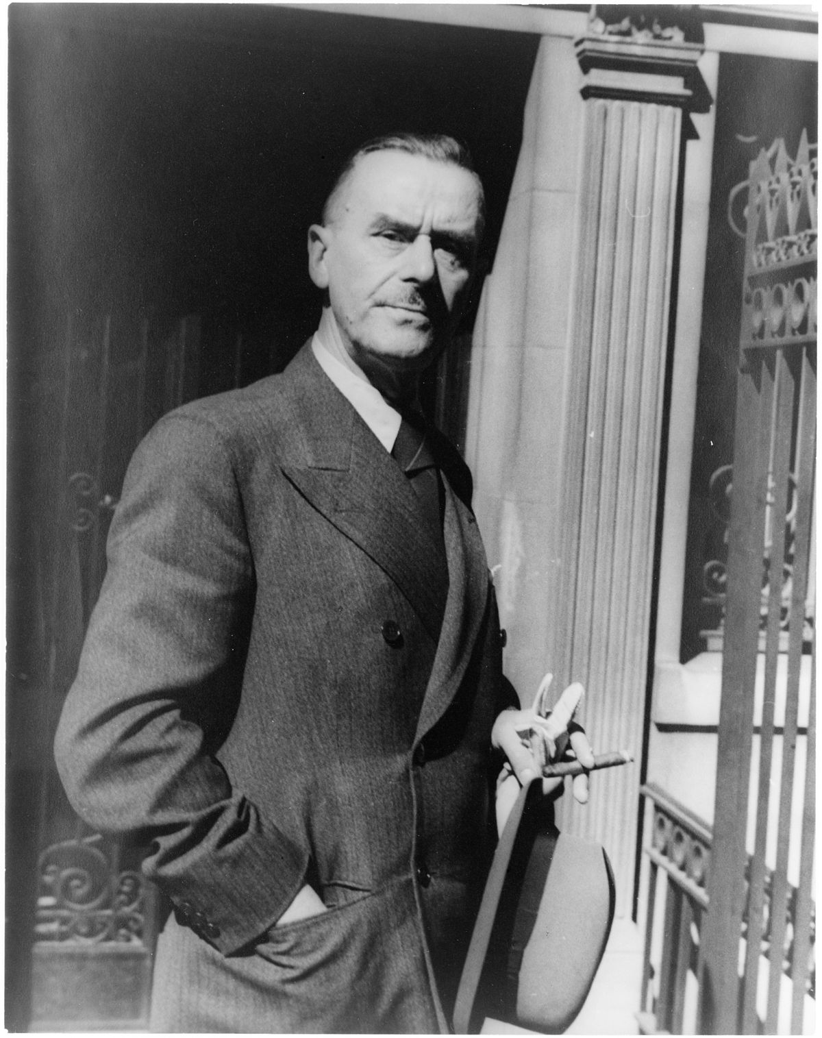 Portrait of Thomas Mann, holding hat, gloves, and cigar.jpg