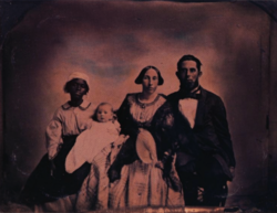 Portrait of a planter's family and slave.png