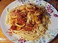Prawns and Squid Rings in a tomato suce on spaghetti (36208289276).jpg