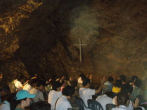 Group of Christians praying in the cave at Yeo...