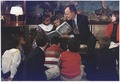 President Bush reads a book to children during Great American Read Aloud Day in the Diplomatic Reception Room - NARA - 186432.tif