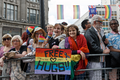 Pride in London 2016 - Girls with Free Hugs sign on the parade route.png