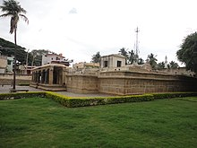 Temple complex with a lawn and a low hedge