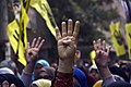 Protesters raise their hands with the four finger R4bia sign during a march in Maadi-Cairo on the six month anniversary of the violent crackdown against supporters of ousted President Morsi 14-Feb-2014.jpg