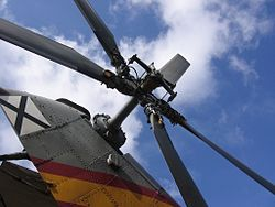 a stationary four-bladed tail rotor atop a vertical pylon