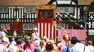 Punch and Judy - A Punch and Judy show attracts a family audience In Thornton Hough, Merseyside, England