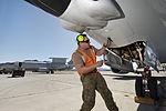 RAAF airman opening a panel on an E-7A.jpg