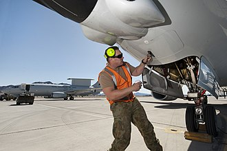 Royal Australian Air Force - A RAAF aircraft technician opening a panel of a Boeing E-7A Wedgetail