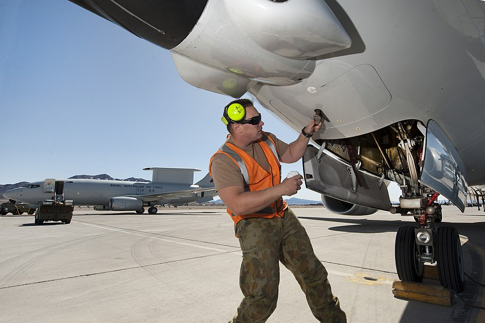 RAAF airman opening a panel on an E-7A