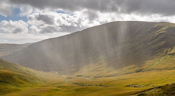Rain over a Scottish catchment. Understanding the cycling of water into, through, and out of catchments is a key element of hydrology. Rain over Beinn Eich, Luss Hills, Scotland.jpg