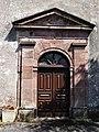 Rebourguil Esplas église portail.jpg
