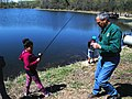 Regional Director Tom Melius Helps a Student with Fishing Bait (8740181849).jpg