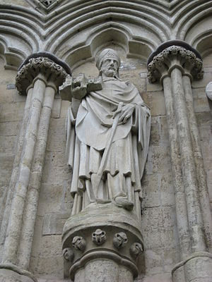 Salisbury Cathedral - Sculpture on the west front of the cathedral of Bishop Richard Poore who oversaw the early years of its construction, beginning in 1220. He is holding a model of the cathedral