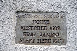 Photo of James I stone plaque