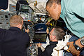STS-133 Steve Lindsey, Eric Boe and Alvin Drew work on the aft flight deck.jpg