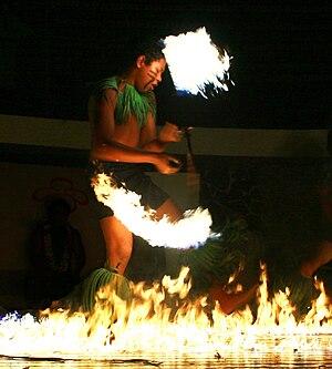 Samoan culture - Boy performing a Samoan fire dance (siva afi).