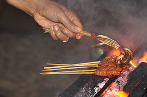 Sauce - Sauce being brushed on satay in the hawker food court at Tanjung Aru beach, Sabah, Borneo, Malaysia.