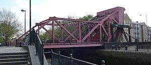 William Donald Scherzer - Scherzer rolling lift bridge example over the entrance to Surrey Water beside the River Thames in London, England