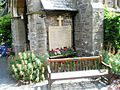 Seat by the war memorial at St John the Baptist, Lynmouth - geograph.org.uk - 936919.jpg