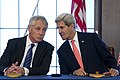 Secretary of Defense Chuck Hagel, left, talks with Secretary of State John Kerry as an amendment between the United States and Japan in refererence to the movement of U.S. Marines from Okinawa to Guam is signed 131003-D-BW835-715.jpg