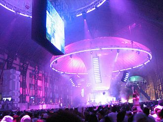Dance party - A rave held in a warehouse-sized venue, with elaborate lighting and powerful sound system.