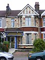 Seven Kings Edwardign stone cladding with blue enclosed porch.jpg
