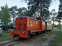 Sharya TU8-0167 with passenger train.jpg