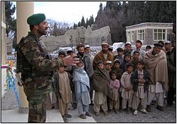 An Afghan Army captain addresses Sherzad village.