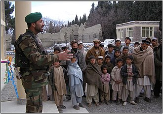 Sherzad - An Afghan Army captain energyes Sherzad village.