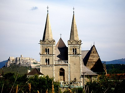 Catholic St.Martin's cathedral in Spisske Podhradie (Slovakia). Behind the cathedral there is the gothic Spis Castle. Slovakia region Spis 33.jpg