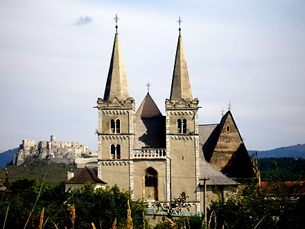 Two main symbols of the medieval Western civilization on one picture: the gothic St. Martin's cathedral in Spisske Podhradie (Slovakia) and the Spis Castle behind the cathedral Slovakia region Spis 33.jpg