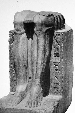 Remains of a statue of the Twelfth Dynasty reappropriated by Hyksos ruler Khyan, with his name inscribed on the sides over an erasure.[1]