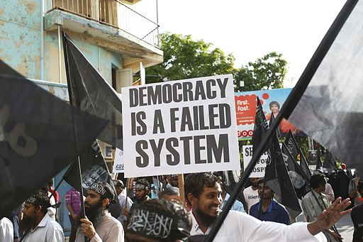 Street protest calling for Sharia in Maldives, Democracy failed system poster